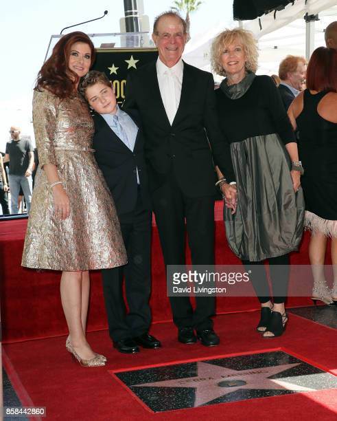 Actress Debra Messing son Roman Walker Zelman father Brian Messing and Karen Bye attend Debra Messing being honored with a Star on the Hollywood Walk...