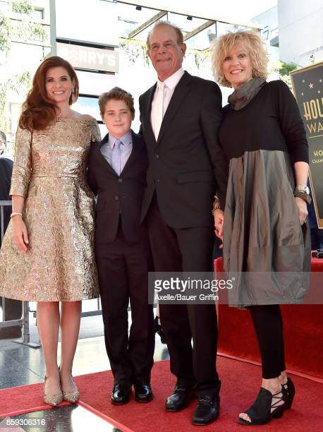 Actress Debra Messing son Roman Walker Zelman father Brian Messing and Karen Bye attend the ceremony honoring Debra Messing with star on the...