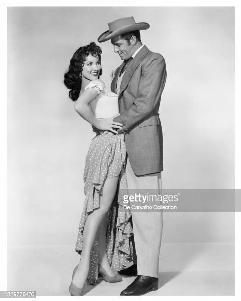 Actress Debra Paget as 'Melanie Barbee' and Actor Dale Robertson as 'Captain Vance Colby' in a publicity shot from the movie 'The Gambler from...