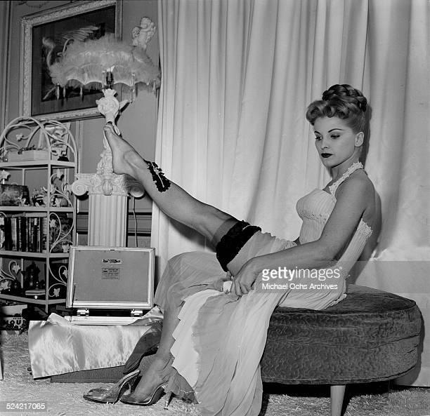 Actress Debra Paget poses in stockings in Los Angeles,CA.