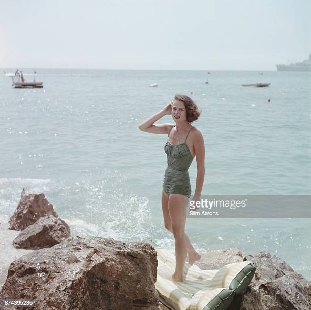 Actress Dee Hartford wife of film producer Howard Hawks relaxing by the sea in Monaco 1957