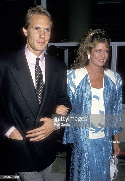 Actress Deidre Hall and date Michael Dubelko attend the Dancers Century City Premiere on October 7 1987 at AMC Century 14 Theatres in Century City...