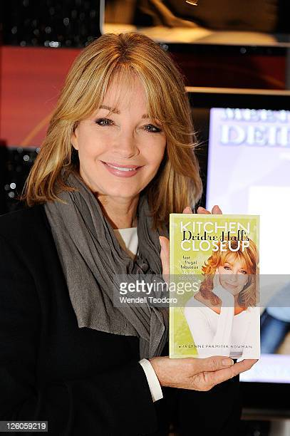 Actress Deidre Hall poses with her book Kitchen Close Up during the Deidre Hall Meet Greet at the NBC Experience Store on September 22 2011 in New...