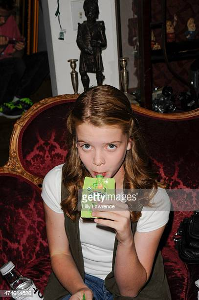 Actress Delaney Raye enjoys GoGo Squeez at the SAP - The Starving Artists Project - Backstage on May 23, 2015 in Los Angeles, California.