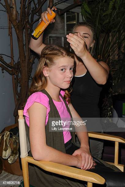 Actress Delaney Raye gets her hair done backstage at The SAP - The Starving Artists Project on May 23, 2015 in Los Angeles, California.