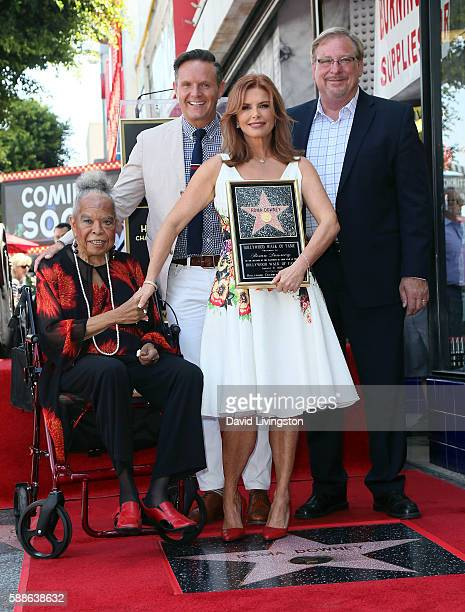 Actress Della Reese, producer Mark Burnett, actress Roma Downey and pastor Rick Warren of Saddleback Church attend Roma Downey being honored with a...