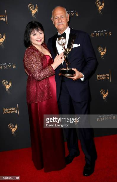 Actress Delta Burke and actor Gerald McRaney pose in the press room with the award for outstanding guest actor in a drama series for This is Us at...
