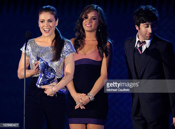 Actress Demi Lovato and actor Simon Helberg present actress Alyssa Milano the Twitter Award onstage at the 2010 VH1 Do Something Awards held at the...