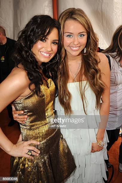 Actress Demi Lovato and actress Miley Cyrus arrive at Nickelodeon's 2009 Kids' Choice Awards at UCLA's Pauley Pavilion on March 28 2009 in Westwood...