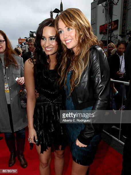 "Actress Demi Lovato and actress/singer Miley Cyrus arrive at the premiere of Walt Disney Picture's ""Hannah Montana: The Movie"" held at the El Captian..."