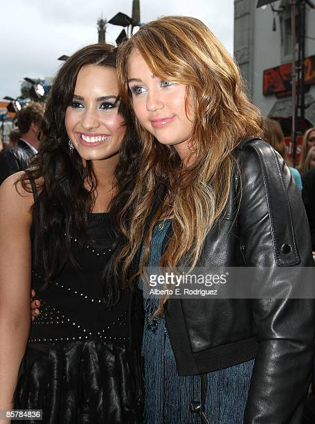 Actress Demi Lovato and actress/singer Miley Cyrus arrive at the premiere of Walt Disney Picture's 'Hannah Montana The Movie' held at the El Captian...