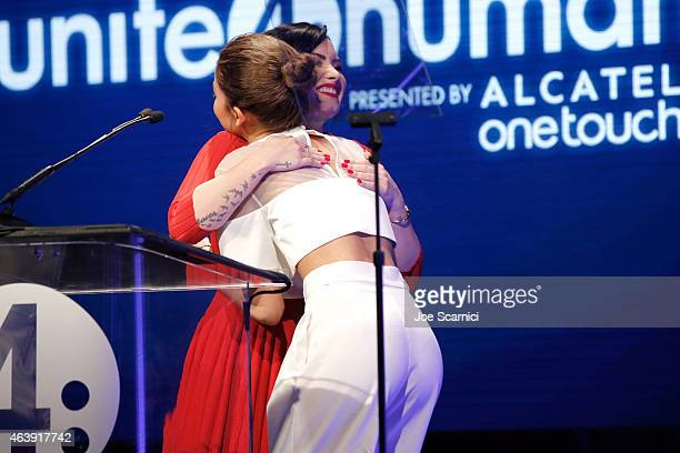 Actress Demi Lovato presents the Young Luminary Award to actress/singer Zendaya onstage at the 2nd Annual unite4humanity presented by ALCATEL...