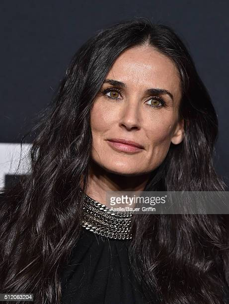 Actress Demi Moore arrives at SAINT LAURENT At The Palladium at Hollywood Palladium on February 10 2016 in Los Angeles California