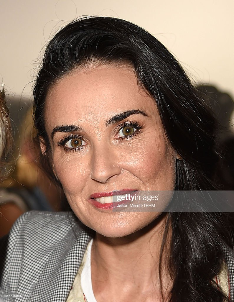 Actress Demi Moore attends the Brian Bowen Smith WILDLIFE show hosted by Casamigos Tequila at De Re Gallery on October 23, 2014 in West Hollywood, California.