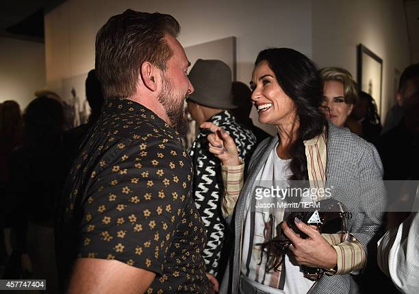Actress Demi Moore greets photographer Brian Bowen Smith at the Brian Bowen Smith WILDLIFE show hosted by Casamigos Tequila at De Re Gallery on...