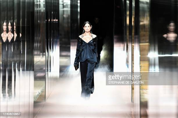 Actress Demi Moore presents a creation of British designer Kim Jones for the Fendi's Spring-Summer 2021 collection during the Paris Haute Couture...