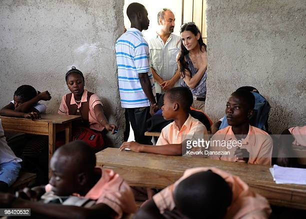 Actress Demi Moore visits a camp for internally displaced persons managed by actor Sean Penn and his JenkinsPenn Humanitarian Relief Organization on...
