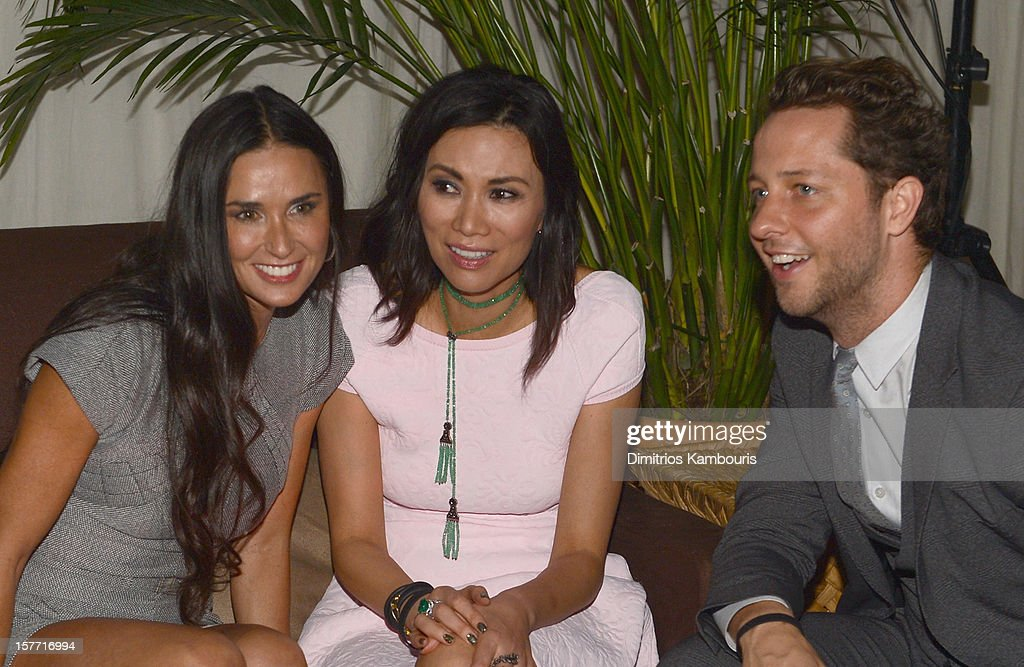 Actress Demi Moore, Wendi Murdoch and writer Derek Blasberg attend a Beachside Barbecue presented by CHANEL hosted by Art.sy Founder Carter Cleveland, Larry Gagosian, Wendi Murdoch, Peter Thiel and Dasha Zhukova at Soho Beach House on December 5, 2012 in Miami Beach, Florida.