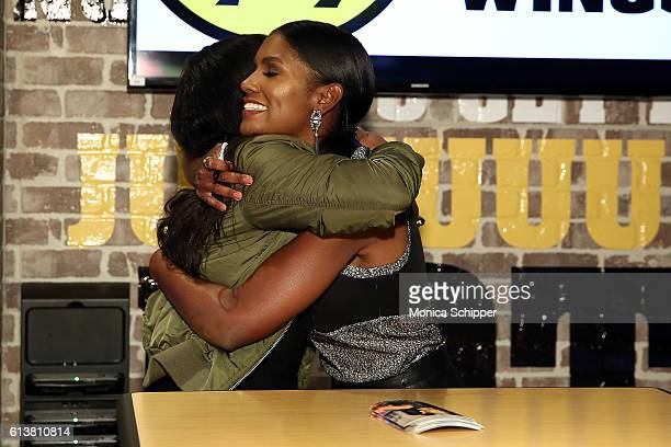 Actress Denise Boutte greets a fan when she visits Buffalo Wild Wings Times Square at Buffalo Wild Wings on October 10 2016 in New York City