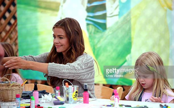 Actress Denise Richards and daughter Lola Rose Sheen decorate jeans at the 77kids American Eagle Denim Decorating Station during the 22nd Annual Time...