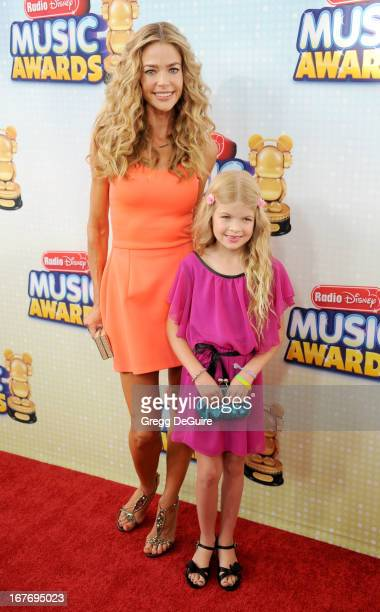 Actress Denise Richards and daughter Lola Sheen arrive at the 2013 Radio Disney Music Awards at Nokia Theatre LA Live on April 27 2013 in Los Angeles...
