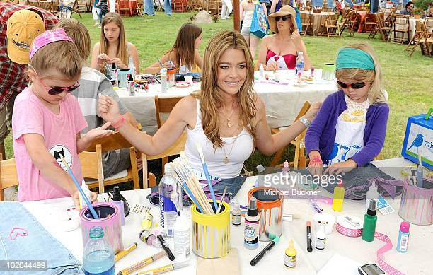 Actress Denise Richards and daughters Sam Sheen and Lola Rose Sheen attend the 77kids by American Eagle Denim Decorating booth at A Time For Heroes...