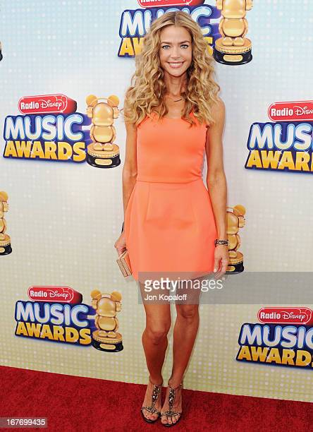 Actress Denise Richards arrives at the 2013 Radio Disney Music Awards at Nokia Theatre LA Live on April 27 2013 in Los Angeles California