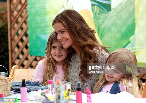 Actress Denise Richards with daughters Sam Sheen and Lola Rose Sheen decorate jeans at the 77kids American Eagle Denim Decorating Station during the...