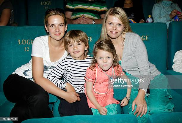 Actress Denise Zich son Julius Faye Montana and actress AnneSophie Briest attend the Berlin premiere of Mullewapp at UCI Kinowelt Colloseum on July...