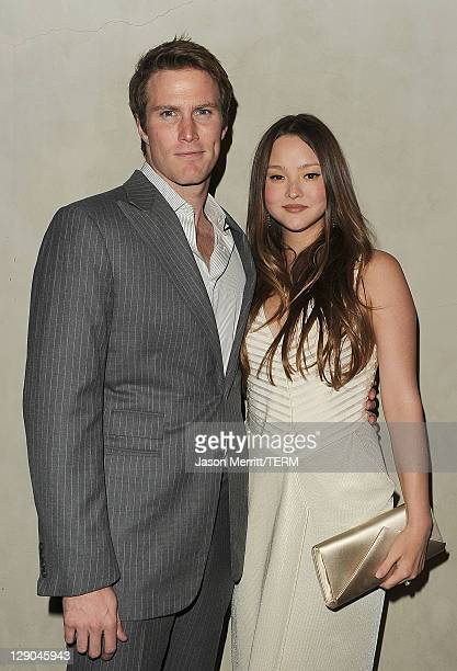 Actress Devon Aoki and husband James Bailey arrive at the Giorgio Armani / Vanity Fair private dinner on October 11 2011 in Los Angeles California