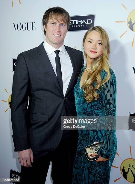 Actress Devon Aoki and James Bailey arrive at the Dream For Future Africa Foundation Gala at Spago on October 24 2013 in Beverly Hills California