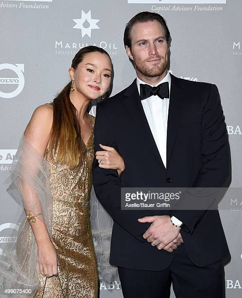 Actress Devon Aoki and James Bailey attend the 2015 Baby2Baby Gala at 3LABS on November 14 2015 in Culver City California