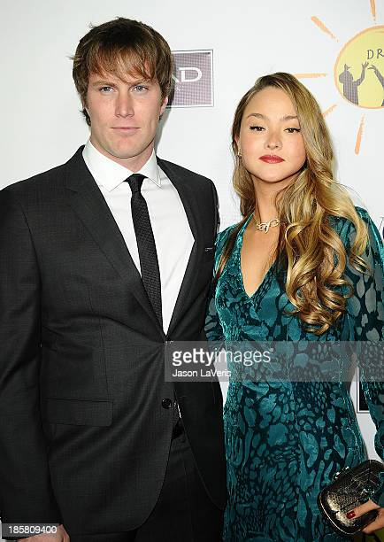 Actress Devon Aoki and James Bailey attend the Dream For Future Africa Foundation gala at Spago on October 24 2013 in Beverly Hills California