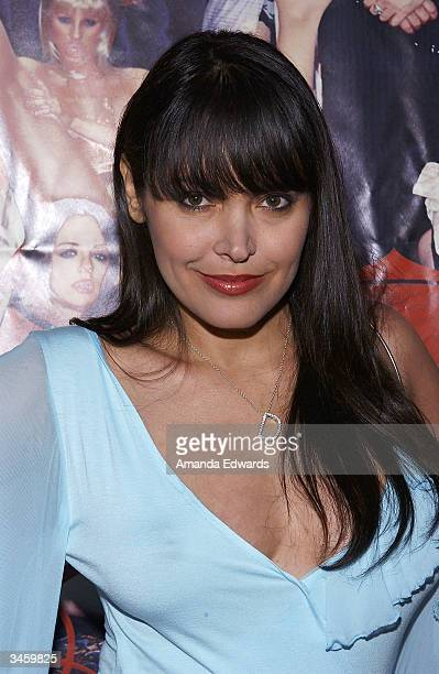 Actress Devon DeVasquez arrives at the record release party for Gene Simmons' 'Asshole' on April 22 2004 at the Key Club in West Hollywood California