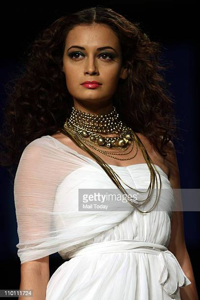 Actress Dia Mirza showcases the creation of designer Rocky S on the 4th day of the Lakme Fashion week Summer Resort 2011 in Mumbai on March 14 2011