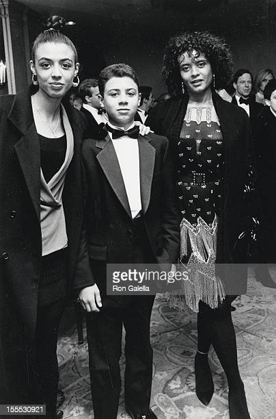 Actress Diahnne Abbott daughter Dreena De Niro and son Raphael De Niro attend the premiere of Awakenings on December 17 1990 at Loew's Fine Arts...