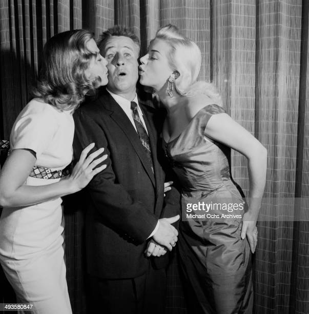 Actress Diana Dors attends a cocktail party with George Gobel and Rita Talbot in Los Angeles, California.