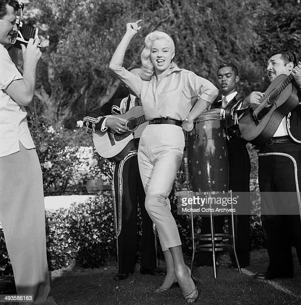 Actress Diana Dors attends a party in Los Angeles, California.