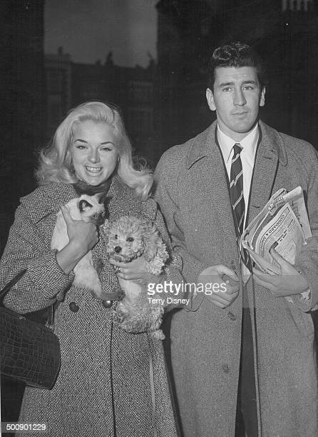 Actress Diana Dors holding a kitten and a dog with her friend Thomas Yeardye arriving at a London court concerning assault charges December 7th 1957