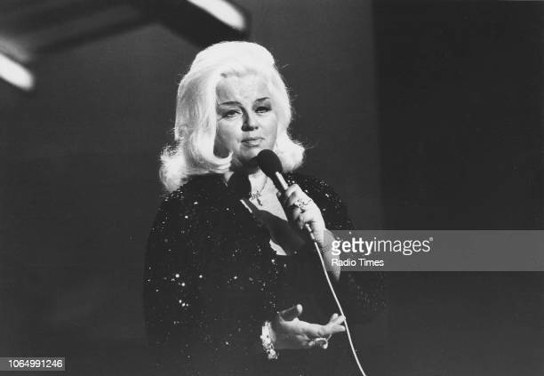 Actress Diana Dors pictured singing on on the television show 'Marti Caine' January 16th 1982