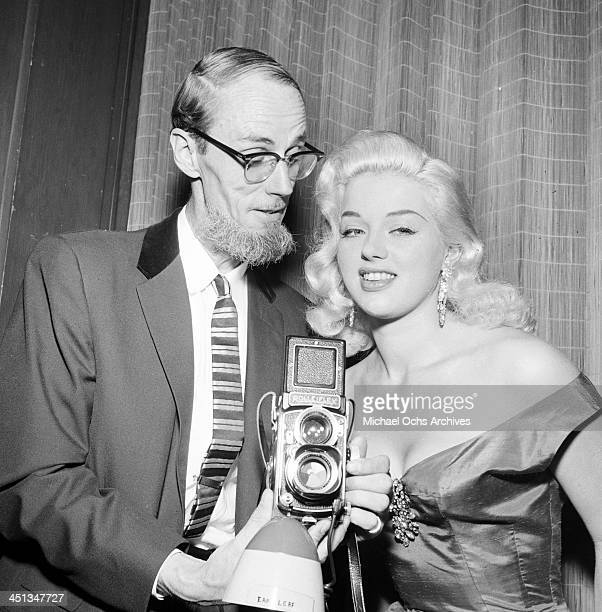 Actress Diana Dors poses with Earl Leaf during a party in Los Angeles California