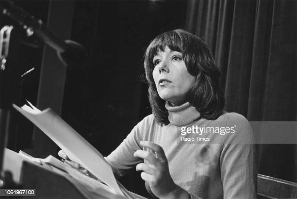 Actress Diana Rigg holding a script and speaking into a microphone April 1978