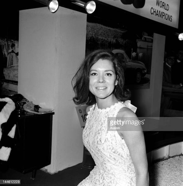 Actress Diana Rigg on the Lotus stand at the London Motor Show at Earls Court, London in October 1965.;
