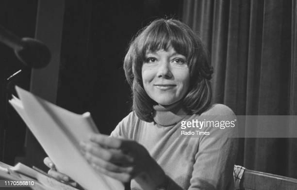Actress Diana Rigg reading a script April 1978