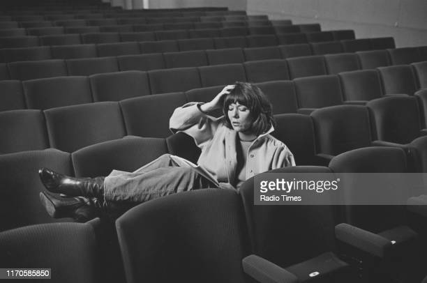 Actress Diana Rigg reading a script in an empty theatre April 1978