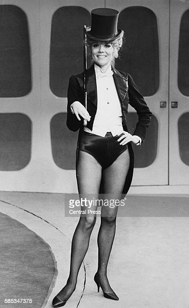 Actress Diana Rigg wearing top hat and tails during rehearsals for the play 'Jumpers', at the Old Vic Theatre, London, January 30th 1973.