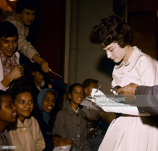 Actress Diane Baker signs her autograph for young fans in Los Angeles California