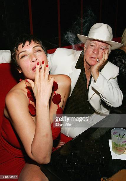Actress Diane Goldner and actor Clu Gulager joke around during the after party at the Little Buddha restaurant following the premiere of the movie...