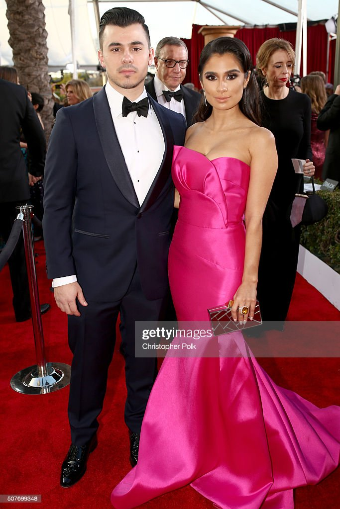 Actress Diane Guerrero (R) and Joseph Ferrara attend The 22nd Annual Screen Actors Guild Awards at The Shrine Auditorium on January 30, 2016 in Los Angeles, California. 25650_018
