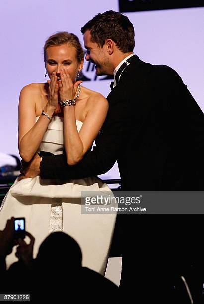 Actress Diane Kruger and actor Joshua Jackson share a joke onstage during the amfAR Cinema Against AIDS 2009 benefit at the Hotel du Cap during the...